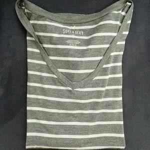 A gray and white striped V Neck t-shirt